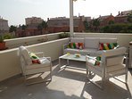 Sit and relax on the south facing terrace. Blinds to pull across for shade