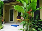 Jepun suite private entrance and veranda with views to pool, garden and bale.