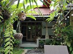 Sandat suite private entrance and veranda with views to pool and garden. Queen bed + double sofa bed