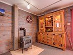 Beautiful hutch holding local art, games, walking sticks for your hike, and a great gas fireplace!