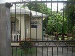 Gated and secure english cottage surrounded by tropical fruit trees