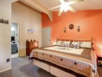 The Cowboy room holds a king bed, walk in closet, balcony access and en suite bathroom.