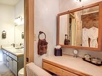 The makeup vanity provides a plush chair to get ready for your day! Amenities and small face mirror!