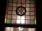 The stained glass window that graces the Master Bathroom entry.