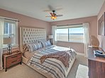After an action-packed day, come home for a rejuvenating rest on the master bedroom's cozy king-sized bed.