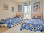 This festive Disney themed room with 2 twin-sized beds is a dream come true for young kids!