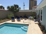 View of Pool and Cushioned Loungers