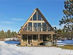 Located at Base of Powderhorn Mtn in the Western Upper Peninsula, A Gorgeous Modern Home with Heated Entryway & Brick Fireplace