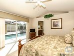 Master bedroom suite w/King bed & flat screen TV also provides incredible views w/direct access to pool/lanai.