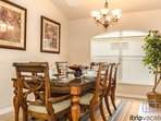 Gorgeous formal dining room table accommodates seating for 6.