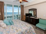 Master bedroom with 32-inch TV/Blu-Ray, seating area and views of beach and Gulf from balcony