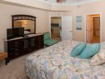 Master bedroom with trayed ceiling and triple dresser