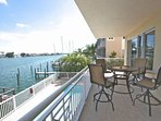 Beautiful Private Patio with Seating for 4-Watch the dolphins and boats go by