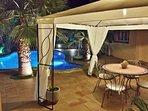 Gazebo next to pool at night time