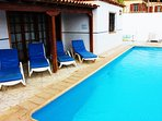 Plenty of sunbeds are provided by the pool along with a barbeque.