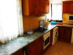 The kitchen is light and spacious with dishwasher and washing machine