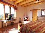 King master bedroom with wood burning kiva fireplace and 1 of 5 Televisions