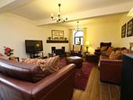 Lounge - 50' TV, Blue Ray DVD, Leather seating for 12, woodburner