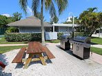 grill area next to pool - free gas grills for guests
