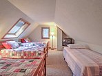 The loft provides additional sleeping with 4 twin-sized beds.