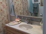 Guest bath; full tub/shower, vanity, towels