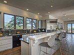 The spacious kitchen has plenty of counterspace and a breakfast bar that seats three.