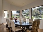 A more formal dining area has that view too, but has the luxury of comfortably seating 8.