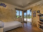 The final guest bedroom hosts a full bed and private patio access.