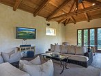 The separate pool house has a fireplace, and plenty of space to kick back and relax.