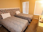 Two full beds shared bath, TV