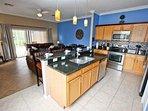New Stainless Steel Appliances, Granite Counter Tops, Tiled Backsplash & Tile Flooring