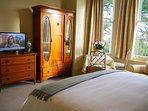 Featuring antique Walnut furniture