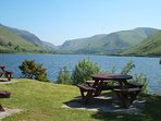 Tal y Llyn. South of Dolgellau. 2 pubs serving food on the lakeside. Fishing.