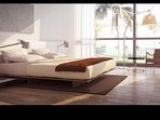Modern style bedroom complete with a queen size bed.