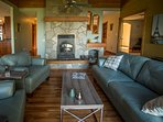 Large custom stone fireplace to keep you warm on chilly winter nights