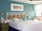 Colorful master bedroom with king sized bed,