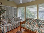 Relax with a new novel in the sunroom.