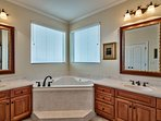1st Master Bath with walk-in shower, Jacuzzi and twin vanities