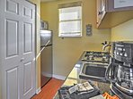 The cozy kitchen offers all the necessary appliances and a nice sized fridge.