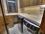 2nd of two laundry rooms.  Large capacity front loading washer and dryer.