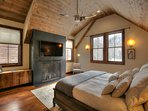 Bring on the night in this super cozy and spacious master bedroom with fireplace and vaulted ceiling