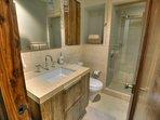 Shared full bathroom (basement level) shower only + single vanity sink
