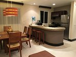 Our dining area and kitchen include a nice stove/oven, microwave, and new refrig in 2016