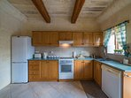 Fully equipped Kitchen leading to garden