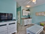 Living Room area of the Cabana features flat screen TV, small frig, coffee maker, bar sink and microwave.