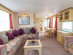 Lounge area book your family holiday in this static caravan.