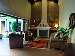 Your beautiful indoor living room with a fireplace and high, vaulted ceilings.