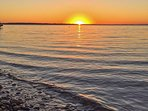 Marvel at the gorgeous sunsets from the sandy shores of the lake!
