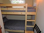 Bedroom 4, with 2 full twin beds.  Room includes closet.  Great for kids!