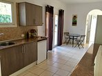 Separate kitchen with double patio doors which drives to the back terrace and garden.